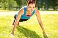 Sporty athletic woman on a grass background outdoor sports healthy sport lifestyle fitness yoga Stock Image