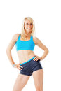 Sporty blonde woman smiling straight to the camera isolated on white Stock Photography