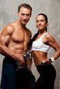 Sporty couple with fitness equipment Royalty Free Stock Image