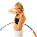 Sporty fit girl doing exercise with hula hoop. Royalty Free Stock Photo