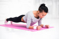 Sporty fit sliming girl doing plank exercise in yoga class. fitness, home and diet concept. Royalty Free Stock Photo