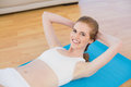 Sporty fit woman doing sit ups in fitness studio portrait of a young on exercise mat Royalty Free Stock Photography