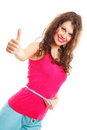 Sporty fit woman with measure tape thumbs up weight loss young fitness measuring her waist giving success hand sign isolated on Royalty Free Stock Image