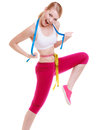 Sporty fit woman with measure tapes. Time for diet slimming. Royalty Free Stock Photo