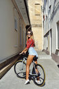 Sporty girl on a bicycle outdoor Royalty Free Stock Photo