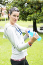Sporty girl with bottle water portrait of young woman energy drink Royalty Free Stock Photos