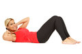 Sporty girl doing situp and smiling on white Stock Photography