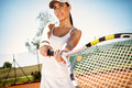 Sporty girl playing tennis player with racket Royalty Free Stock Photography