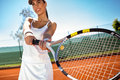 Sporty girl playing tennis smiling young Stock Images