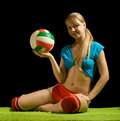 Sporty girl posing with volley-ball Royalty Free Stock Images