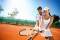Sporty girl practice tennis with  coach Royalty Free Stock Photo