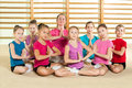 Sporty girls with coach active in gym Royalty Free Stock Photo