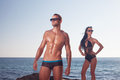 Sporty guy showing his perfect oiled body girl behind Royalty Free Stock Photo