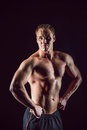 Sporty and healthy muscular strong man isolated on black background Royalty Free Stock Photo