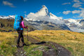 Sporty hiker woman with Matterhorn peak in background,Valais,Switzerland Royalty Free Stock Photo