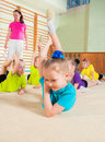 Sporty little girls gymnastics coach teaching in gym Stock Image