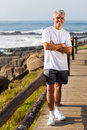 Sporty man beach middle aged portrait at the in the morning Stock Photography