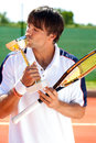 Sporty man kissing trophy glad victory at sport competition Royalty Free Stock Photography