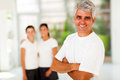 Sporty mature man men in front of his family at home gym Royalty Free Stock Image