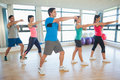 Sporty people doing power fitness exercise at yoga class full length of Stock Image