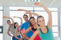Sporty people doing power fitness exercise at yoga class portrait of in row Stock Photography