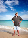 Sporty senior man casual doing exercise on beach Royalty Free Stock Image