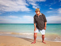 Sporty senior man casual doing exercise on beach Royalty Free Stock Photos
