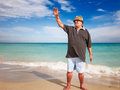 Sporty senior man casual doing exercise on beach Stock Photography