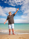 Sporty senior man casual doing exercise on beach Stock Photo