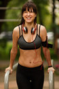 Sporty smiling woman doing strength training for arms Royalty Free Stock Photo