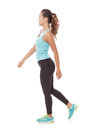 Sporty styles woman in walking pose Royalty Free Stock Photo