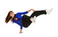 Sporty teenage break dancer in action a dance girl holds a hand stand pose Royalty Free Stock Images