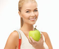 Sporty woman with apple and measuring tape beautiful Royalty Free Stock Photos