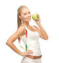 Sporty woman with apple and measuring tape beautiful Royalty Free Stock Images