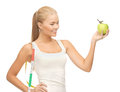 Sporty woman with apple and measuring tape beautiful Stock Photography
