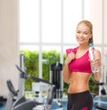 Sporty woman with bottle of water and towel fitness healthcare dieting concept smiling Stock Image