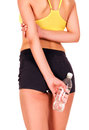 Sporty woman with a bottle white background isolated Royalty Free Stock Photo