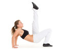 Sporty woman does exercises fitness beautiful on a white background Royalty Free Stock Images