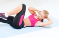 Sporty woman doing exercise on the floor Royalty Free Stock Images