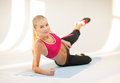 Sporty woman doing exercise on the floor beautiful Stock Photography