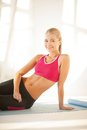 Sporty woman doing exercise on the floor beautiful Royalty Free Stock Photo
