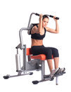 Sporty woman doing exercises on gym equipment Royalty Free Stock Photography
