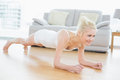 Sporty woman doing push ups in fitness studio smiling beautiful young Royalty Free Stock Image