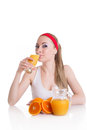 Sporty woman drinking orange juice Stock Photography