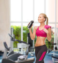 Sporty woman drinking water from sportsman bottle fitness healthcare and dieting concept smiling Stock Photo