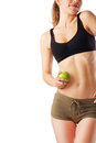 Sporty woman in fitness dress holding green apple isolated on white Stock Images