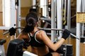 Sporty woman in the gym sports young doing exercises on lat machine Stock Photo