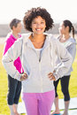 Sporty woman with hands on hips in front of friends Royalty Free Stock Photo