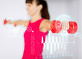 Sporty woman hands with light red dumbbells sport fitness training and happiness concept Royalty Free Stock Photo