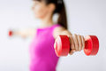 Sporty woman hands with light red dumbbells sport and recreation concept Royalty Free Stock Photos
